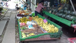 Fruit displayed on rollers at Maeklong Railway Market, Samut Songkhram, Thailand