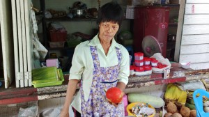 Fruit vendor at Maeklong Market, Samut Songkhram, Thailand