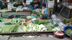 Vegetables offered on both sides of the railroad track, Samut Songkhram, Thailand.